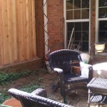 Before: Side fence and sitting area